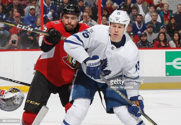 Cody Ceci of the Ottawa Senators battles for position against Matt Martin of the Toronto Maple Leafs at Canadian Tire Centre on October 21 2017 in...