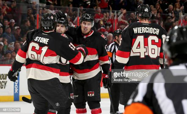 Cody Ceci of the Ottawa Senators celebrates his first period goal against the Chicago Blackhawks with teammates Mark Stone Clarke MacArthur and...