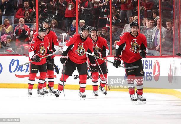 Cody Ceci of the Ottawa Senators celebrates his second period goal against the Carolina Hurricanes with teammates Erik Condra David Legwand Curtis...
