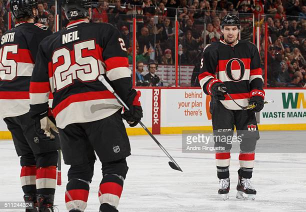 Cody Ceci of the Ottawa Senators celebrates his third period goal against the Carolina Hurricanes with teammates Zack Smith and Chris Neil at...
