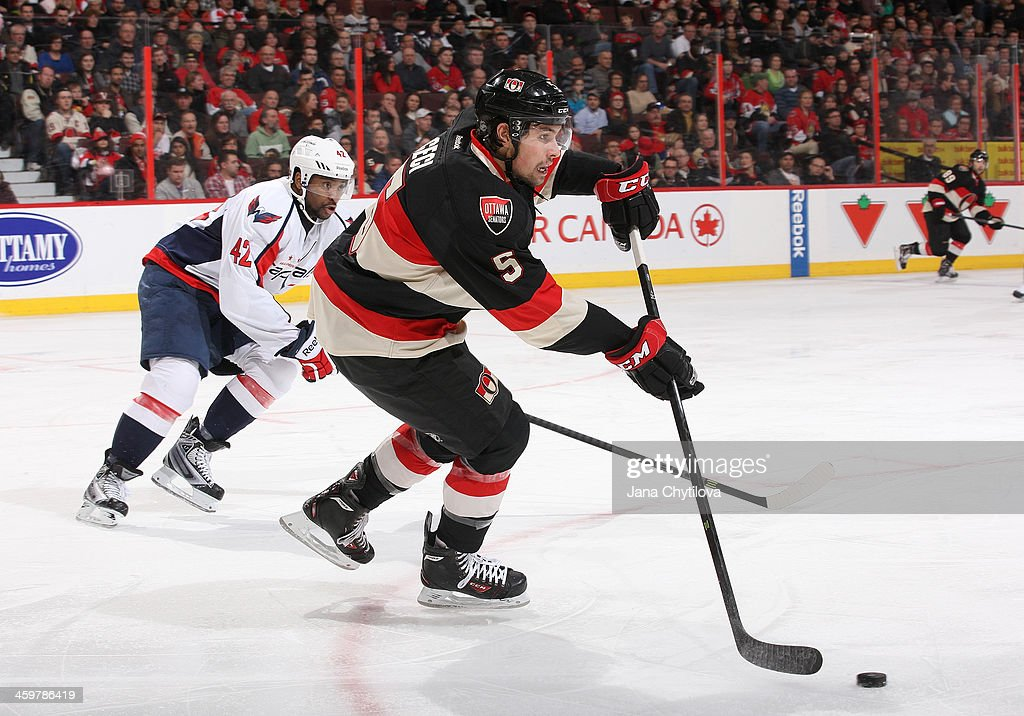 <a gi-track='captionPersonalityLinkClicked' href=/galleries/search?phrase=Cody+Ceci&family=editorial&specificpeople=7324783 ng-click='$event.stopPropagation()'>Cody Ceci</a> #5 of the Ottawa Senators clears the puck past Joel Ward #42 of the Washington Capitals during an NHL game at Canadian Tire Centre on December 30, 2013 in Ottawa, Ontario, Canada.