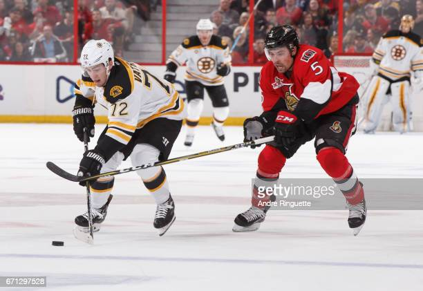 Cody Ceci of the Ottawa Senators defends against Frank Vatrano of the Boston Bruins as he skates up ice with the puck in Game Five of the Eastern...