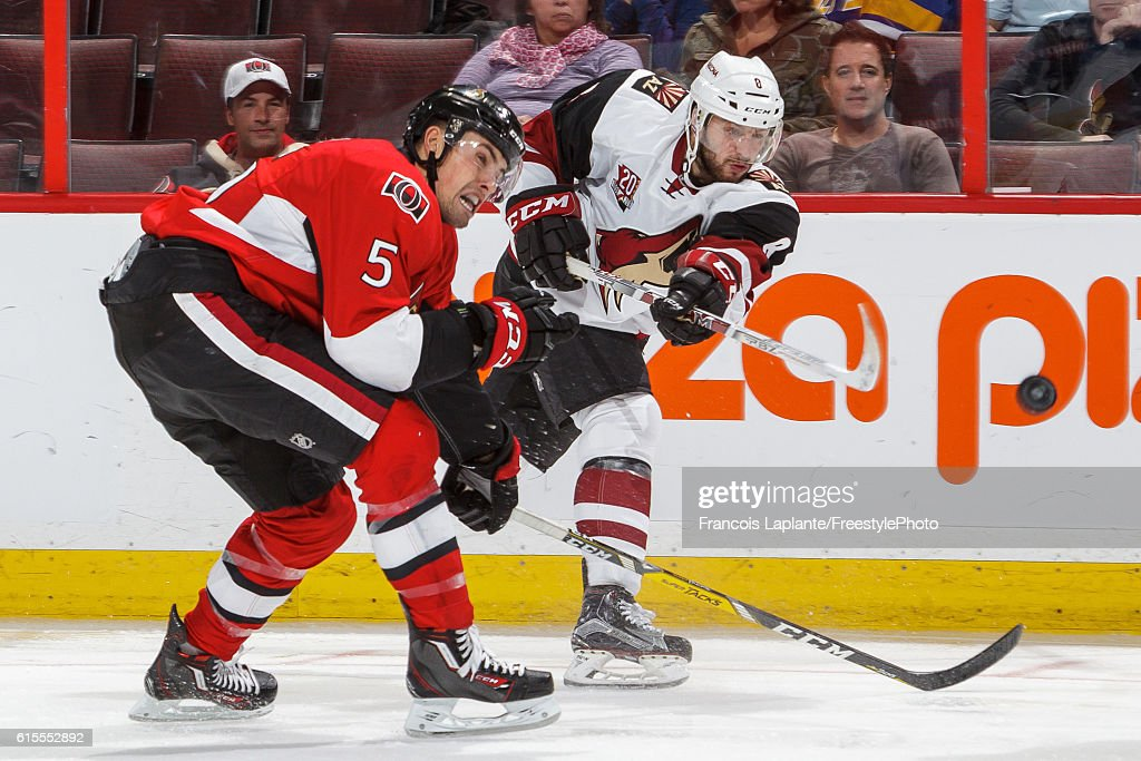 Cody Ceci #5 of the Ottawa Senators defends as Tobias Rieder #8 of the Arizona Coyotes fires a shot during an NHL game at Canadian Tire Centre on October 18, 2016 in Ottawa, Ontario, Canada.