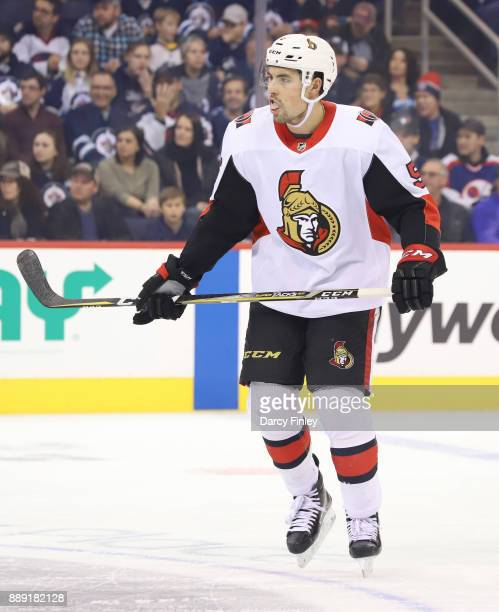 Cody Ceci of the Ottawa Senators keeps an eye on the play during first period action against the Winnipeg Jets at the Bell MTS Place on December 3...