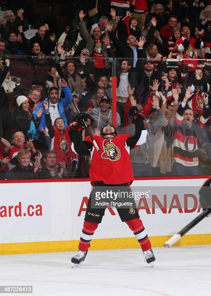 Cody Ceci of the Ottawa Senators raises his arms to celebrate his first career NHL goal which was the overtimewinning goal against the St Louis Blues...