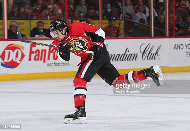 Cody Ceci of the Ottawa Senators shoots the puck against the Arizona Coyotes at Canadian Tire Centre on January 31 2015 in Ottawa Ontario Canada