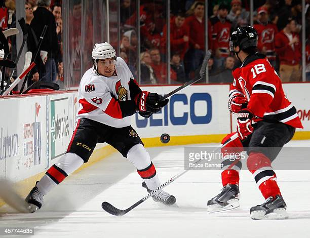 Cody Ceci of the Ottawa Senators shoots the puck into the offensive zone in the game against the New Jersey Devils at the Prudential Center on...