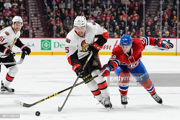 Cody Ceci of the Ottawa Senators skates the puck against Charles Hudon of the Montreal Canadiens during the NHL game at the Bell Centre on December...