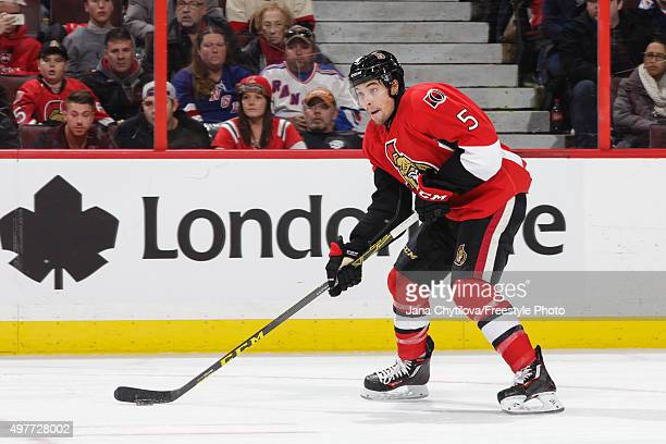 Cody Ceci of the Ottawa Senators skates with the puck against the New York Rangers during an NHL game at Canadian Tire Centre on November 14 2015 in...
