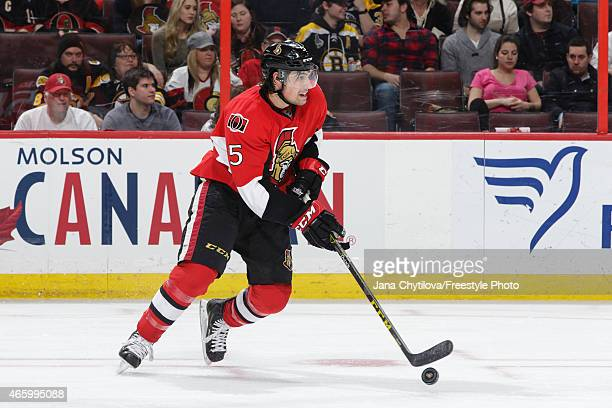 Cody Ceci of the Ottawa Senators skates with the puck against the Boston Bruins at Canadian Tire Centre on March 10 2015 in Ottawa Ontario Canada