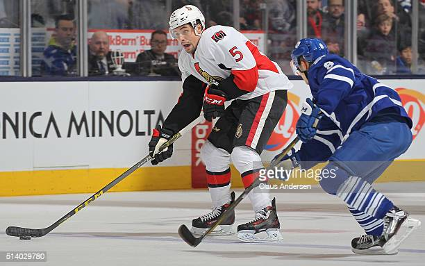 Cody Ceci of the Ottawa Senators skates with the puck against the Toronto Maple Leafs during an NHL game at the Air Canada Centre on March 52016 in...