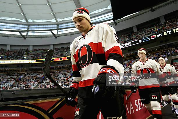Cody Ceci of the Ottawa Senators walks out before playing the Vancouver Canucks during the 2014 Tim Hortons NHL Heritage Classic game at BC Place on...