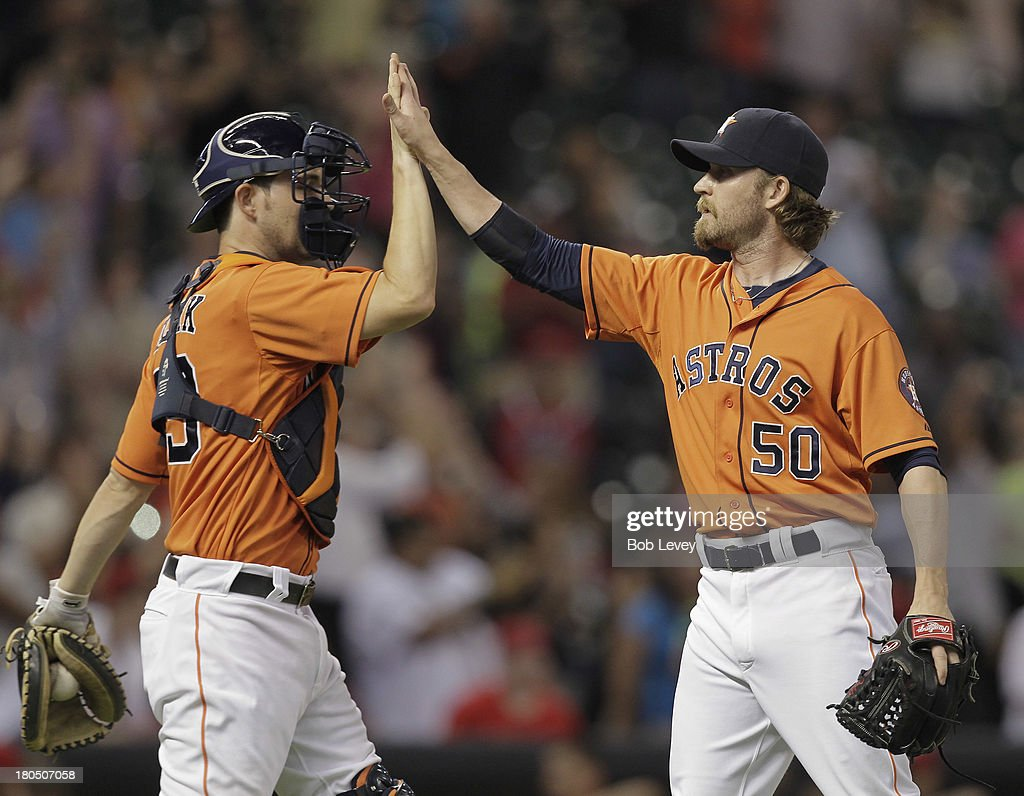 Cody Clark #39 of the Houston Astros high fives <a gi-track='captionPersonalityLinkClicked' href=/galleries/search?phrase=Josh+Fields&family=editorial&specificpeople=711103 ng-click='$event.stopPropagation()'>Josh Fields</a> #50 of the Houston Astros after the final out against the Los Angeles Angels of Anaheim at Minute Maid Park on September 13, 2013 in Houston, Texas.