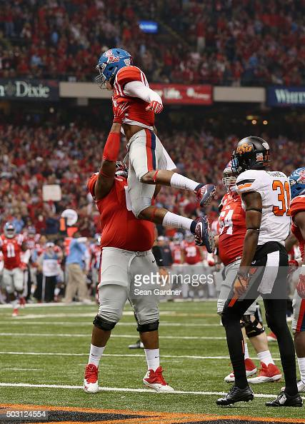 Cody Core of the Mississippi Rebels celebrates his touchdown against the Oklahoma State Cowboys during the first quarter of the Allstate Sugar Bowl...