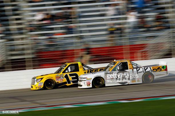 Cody Coughlin driver of the JEGS Toyota races Kaz Grala driver of the Kiklos Greek Extra Virgin Olive Oil Chevrolet during the NASCAR Camping World...