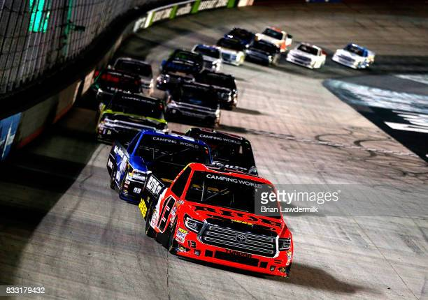 Cody Coughlin driver of the Ride TV/JEGS Toyota leads a group of trucks during the NASCAR Camping World Truck UNOH 200 at Bristol Motor Speedway on...