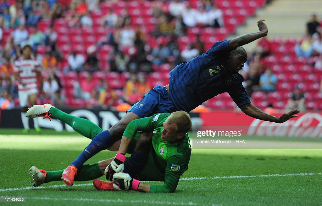 Cody Cropper of USA hits Dimitri Foulquier of France during the FIFA U-20 World Cup Group A match between France and USA at the Ali Sami Yen Arena on June 24, 2013 in Istanbul, Turkey.