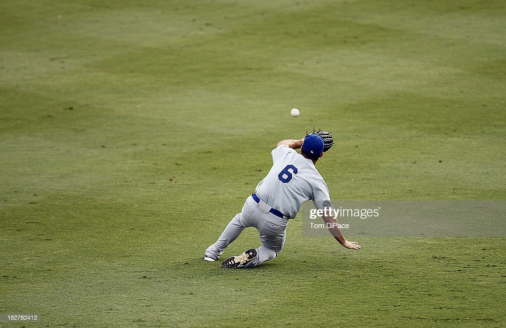 Cody Decker #6 of Team Israel makes a sliding catch against Team Spain during game 6 of the Qualifying Round of the World Baseball Classic at Roger Dean Stadium on September 23, 2012 in Jupiter, Florida.