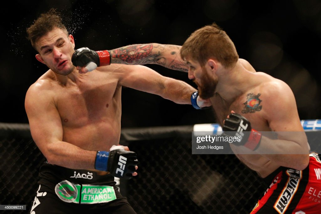 Cody Donovan punches Gian Villante in their light heavyweight bout during the UFC 167 event inside the MGM Grand Garden Arena on November 16, 2013 in Las Vegas, Nevada.