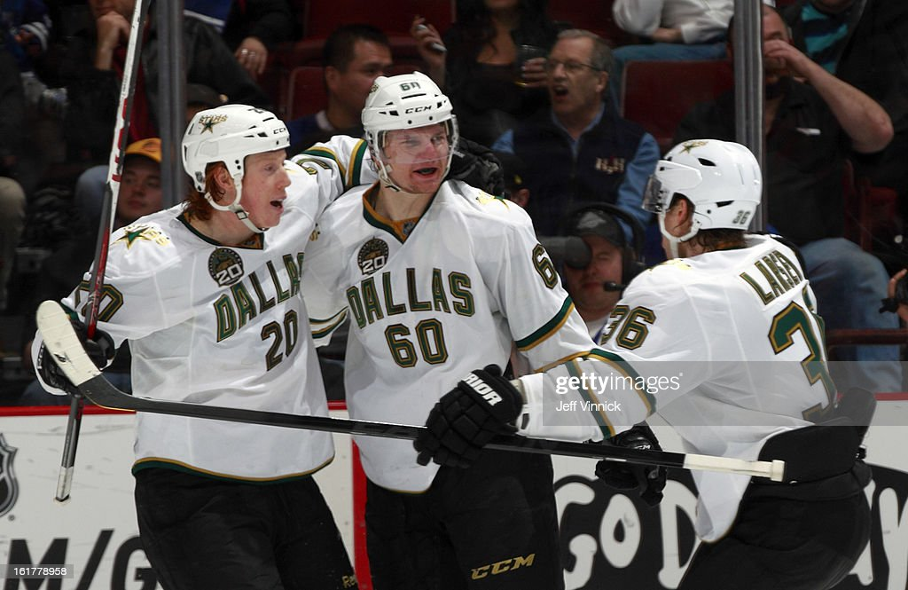 <a gi-track='captionPersonalityLinkClicked' href=/galleries/search?phrase=Cody+Eakin&family=editorial&specificpeople=5662792 ng-click='$event.stopPropagation()'>Cody Eakin</a> #20 and Philip Larsen #36 congratulate Antoine Roussel #60 of the Dallas Stars who scored against the Vancouver Canucks at Rogers Arena February 15, 2013 in Vancouver, British Columbia, Canada. Dallas won 4-3.