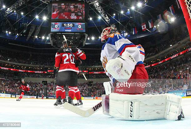 Cody Eakin of Canada celebrates after scoring the opening goal whilst dejected goaltender Sergei Bobrovski of Russia looks on during the 2015 IIHF...