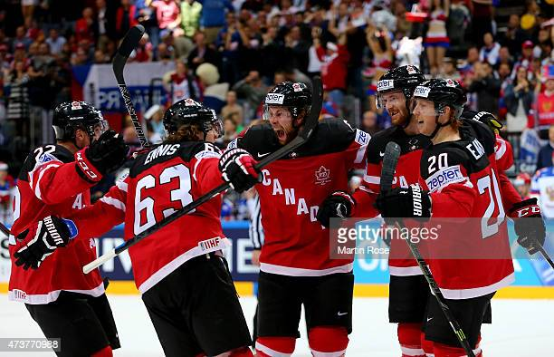 Cody Eakin of Canada celebratw eith his team mates after scoring the opening goal during the IIHF World Championship gold medal match between Canada...