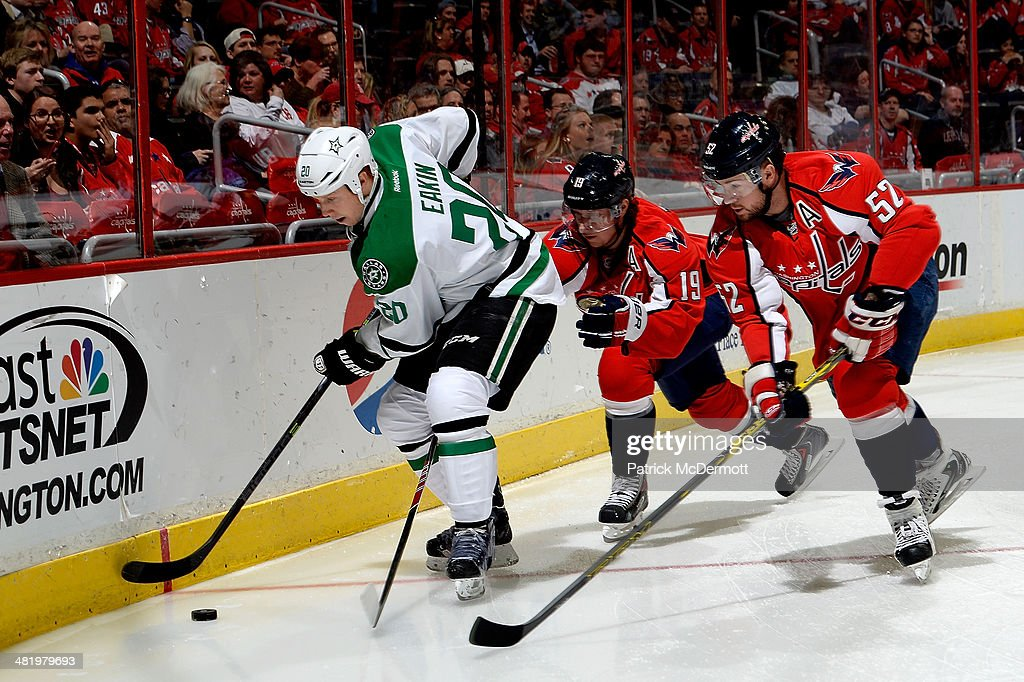 <a gi-track='captionPersonalityLinkClicked' href=/galleries/search?phrase=Cody+Eakin&family=editorial&specificpeople=5662792 ng-click='$event.stopPropagation()'>Cody Eakin</a> #20 of the Dallas Stars battles for the puck against Nicklas Backstrom #19 and Mike Green #52 of the Washington Capitals in the first period during an NHL game at Verizon Center on April 1, 2014 in Washington, DC.