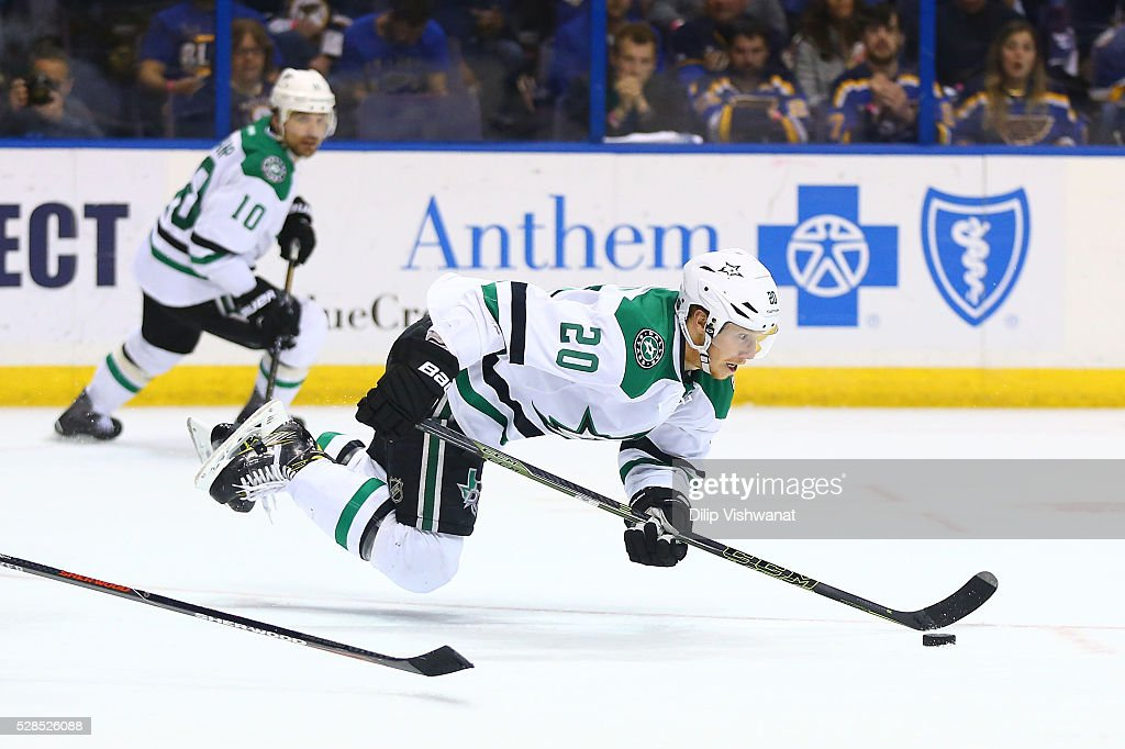 <a gi-track='captionPersonalityLinkClicked' href=/galleries/search?phrase=Cody+Eakin&family=editorial&specificpeople=5662792 ng-click='$event.stopPropagation()'>Cody Eakin</a> #20 of the Dallas Stars is tripped while controlling the puck against the St. Louis Blues in Game Four of the Western Conference Second Round during the 2016 NHL Stanley Cup Playoffs at the Scottrade Center on May 5, 2016 in St. Louis, Missouri.