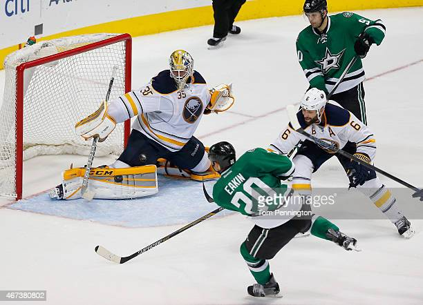 Cody Eakin of the Dallas Stars scores a goal against Anders Lindback of the Buffalo Sabres as Mike Weber of the Buffalo Sabres defends in the third...