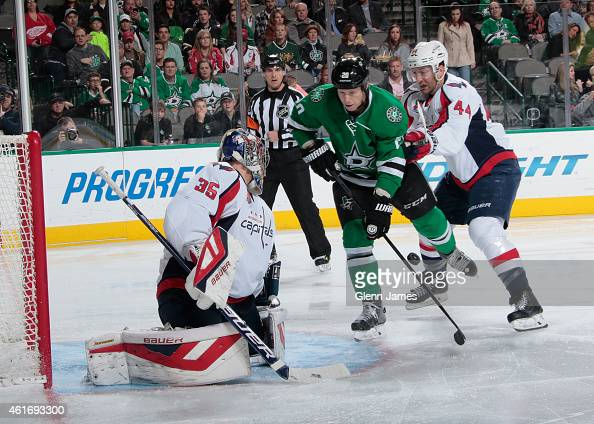 Cody Eakin of the Dallas Stars tries to get a puck in against Justin Peters of the Washington Capitals at the American Airlines Center on January 17...