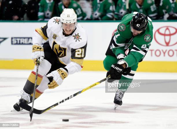 Cody Eakin of the Vegas Golden Knights and Alexander Radulov of the Dallas Stars vie for the puck during the season opening game at American Airlines...