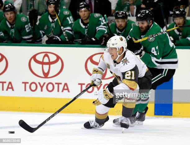 Cody Eakin of the Vegas Golden Knights skates with the puck against Alexander Radulov of the Dallas Stars during the season opening game at American...