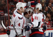 Cody Eakin of the Washington Capitals celebrates his third period goal with teammates John Erskine nd Alexander Semin during a NHL game against the...