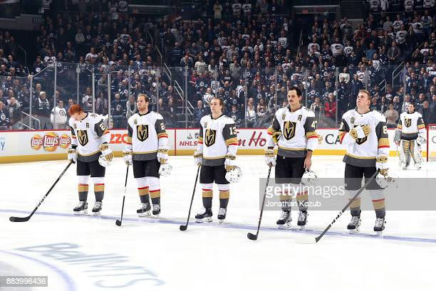 Cody Eakin Oscar Lindberg Brendan Leipsic Luca Sbisa and Nate Schmidt of the Vegas Golden Knights stand on the ice during the singing of the National...