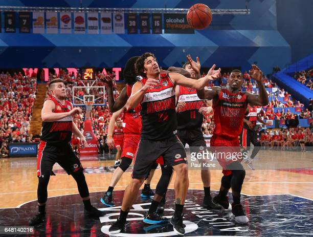 Cody Ellis of the Hawks and Casey Prather of the Wildcats contest for a rebound during game three of the NBL Grand Final series between the Perth...