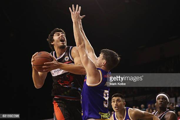 Cody Ellis of the Hawks drives to the basket under pressure from Shaun Bruce of the Bullets during the round five NBL match between the Illawarra...