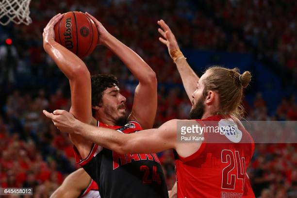 Cody Ellis of the Hawks looks to pass the ball against Jesse Wagstaff of the Wildcats during game one of the NBL Grand Final series between the Perth...
