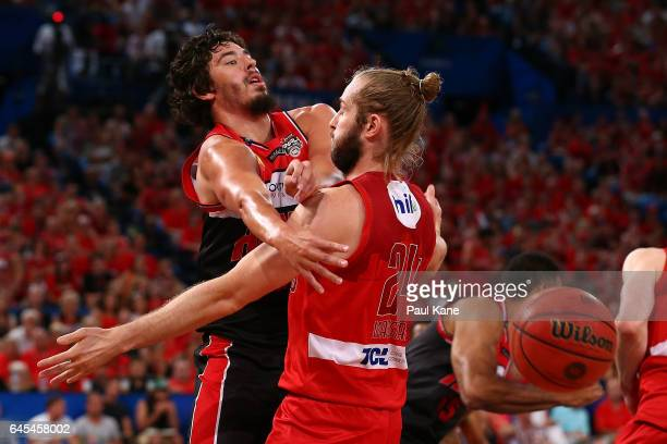Cody Ellis of the Hawks passes the ball against Jesse Wagstaff of the Wildcats during game one of the NBL Grand Final series between the Perth...