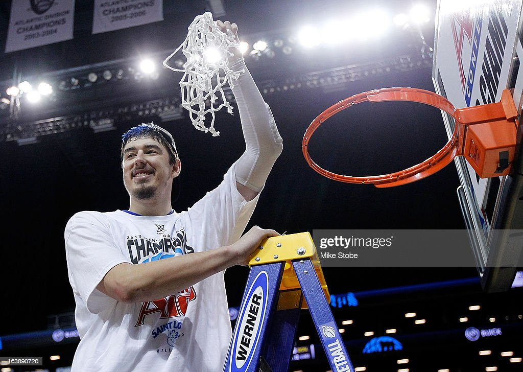 Cody Ellis #24 of the Saint Louis Billikens cuts down the net after winning the A10 championship against Virginia Commonwealth Rams during the Atlantic 10 Basketball Tournament - Championship Game at Barclays Center on March 17, 2013 in the Brooklyn borough of New York City. Saint Louis Billikens defeated Virginia Commonwealth Rams 62-56.