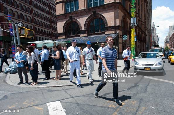 Cody Eppley of the New York Yankees and Kirk Nieuwenhuis of the New York Mets walk to Astor Place June 8 2012 in New York City