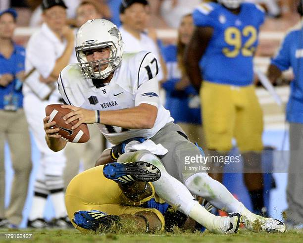Cody Fajardo of the Nevada Wolf Pack is sacked by Keenan Graham of the UCLA Bruins on third down in the third quarter at Rose Bowl on August 31 2013...