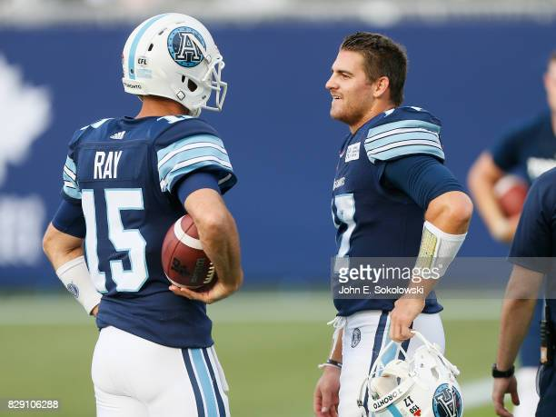 Cody Fajardo of the Toronto Argonauts talks to Ricky Ray of the Toronto Argonauts during the warm up of a CFL game at BMO Field against the Calgary...