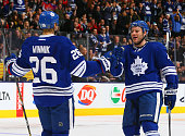 Cody Franson and Daniel Winnik of the Toronto Maple Leafs celebrate Cody Franson goal against the Washington Capitals during game action on January 7...