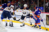 Cody Franson of the Buffalo Sabres battles for the puck against Steve Bernier of the New York Islanders at the Barclays Center on November 1 2015 in...