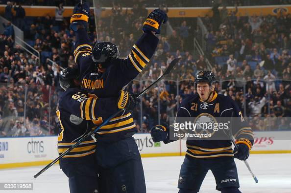 Cody Franson of the Buffalo Sabres celebrates his third period goal with Tyler Ennis and Kyle Okposo during an NHL game against the New York Rangers...