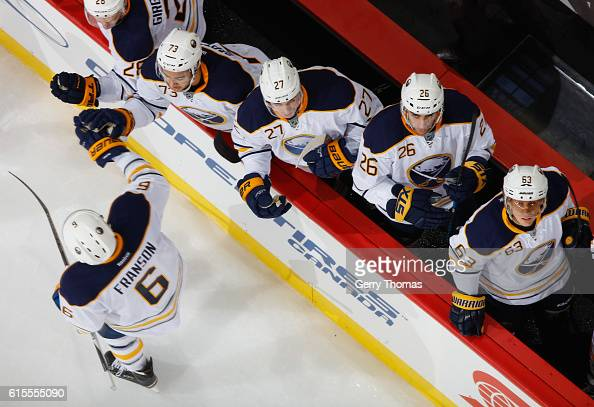 Cody Franson of the Buffalo Sabres celebrates with teammates after a goal against the Calgary Flames at Scotiabank Saddledome on October 18 2016 in...