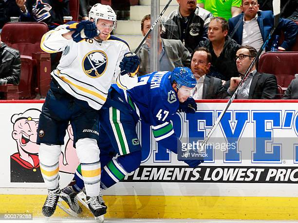 Cody Franson of the Buffalo Sabres checks Sven Baertschi of the Vancouver Canucks during their NHL game at Rogers Arena December 7 2015 in Vancouver...