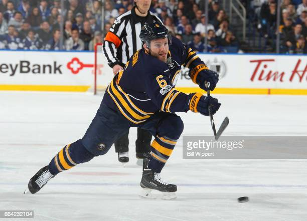 Cody Franson of the Buffalo Sabres fires the puck against the Toronto Maple Leafs during an NHL game at the KeyBank Center on April 3 2017 in Buffalo...