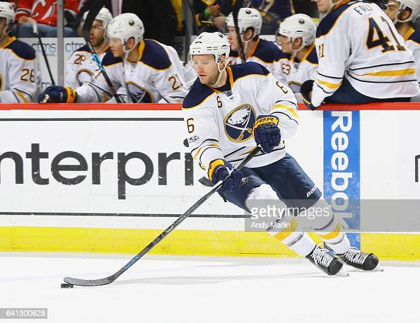 Cody Franson of the Buffalo Sabres plays the puck against the New Jersey Devils during the game at Prudential Center on February 6 2017 in Newark New...