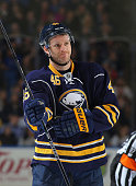 Cody Franson of the Buffalo Sabres prepares for a faceoff against the Carolina Hurricanes during an NHL game on November 27 2015 at the First Niagara...